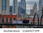 Stock photo clothes line drying on a new york city rooftop 1160427199