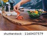 preparing the table for dinner...   Shutterstock . vector #1160437579