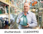 man buys automobile chemicals in the auto parts store - stock photo