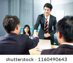 two asian business men shaking... | Shutterstock . vector #1160490643