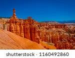 great spires carved away by... | Shutterstock . vector #1160492860
