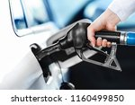 woman pumping petrol at gas... | Shutterstock . vector #1160499850