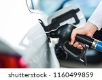 woman pumping petrol at gas... | Shutterstock . vector #1160499859