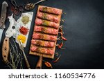 raw kebab with spices and old... | Shutterstock . vector #1160534776