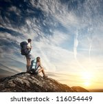 two tourists with backpacks... | Shutterstock . vector #116054449
