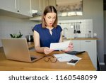 stressed over bills. portrait... | Shutterstock . vector #1160548099