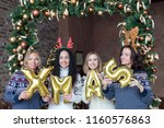 young women holding word xmas... | Shutterstock . vector #1160576863