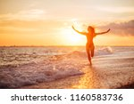 carefree woman dancing in the... | Shutterstock . vector #1160583736