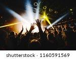 silhouette of concert crowd... | Shutterstock . vector #1160591569