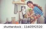 young woman in the kitchen...   Shutterstock . vector #1160592520