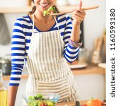 young woman eating fresh salad...   Shutterstock . vector #1160593180
