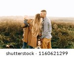 a portrait of a happy family... | Shutterstock . vector #1160621299
