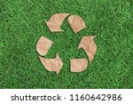 Recycle Symbol On Green Grass...