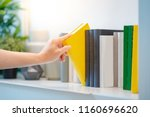 male student hand choosing and...   Shutterstock . vector #1160696620