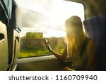 blond woman sitting at train... | Shutterstock . vector #1160709940