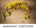 yellow forsythia on old wooden... | Shutterstock . vector #1160712436
