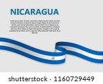 waving flag of nicaragua ... | Shutterstock .eps vector #1160729449
