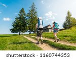 young happy couple hikking with ... | Shutterstock . vector #1160744353