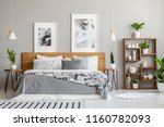 patterned blanket on wooden bed ... | Shutterstock . vector #1160782093