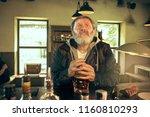 sad senior bearded man drinking ...   Shutterstock . vector #1160810293