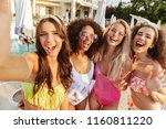 four excited young women in... | Shutterstock . vector #1160811220