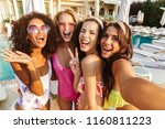 four lovely young women in... | Shutterstock . vector #1160811223