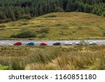 parked cars at the old man of... | Shutterstock . vector #1160851180