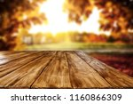 table background and autumn... | Shutterstock . vector #1160866309