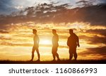three men silhouettes with... | Shutterstock . vector #1160866993