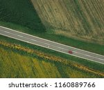 aerial shot of car on the road... | Shutterstock . vector #1160889766
