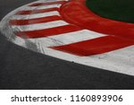 Red White Curb With Tyre Skid...
