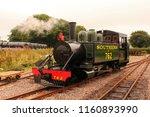 woody bay railway station.... | Shutterstock . vector #1160893990
