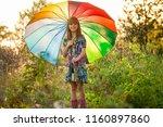 happy child girl walk with...   Shutterstock . vector #1160897860