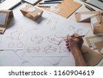 designer sketching drawing... | Shutterstock . vector #1160904619