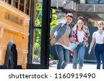group of happy teen scholars... | Shutterstock . vector #1160919490