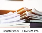 unfinished documents stacks of... | Shutterstock . vector #1160925196