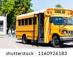 school bus standing on parking... | Shutterstock . vector #1160926183