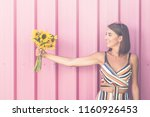 beautiful young girl holding...   Shutterstock . vector #1160926453