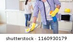 cut view of man cleaning the... | Shutterstock . vector #1160930179