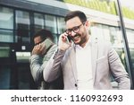 young smiling businessman is... | Shutterstock . vector #1160932693