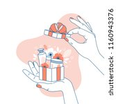 woman hand holding a gift box... | Shutterstock .eps vector #1160943376