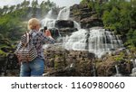 the tourist photographs the... | Shutterstock . vector #1160980060