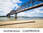 The Big Four Bridge that connects Kentucky and Indiana is an old railroad truss bridge, originally built in 1895, and was converted into a path for people to walk, run and bike across the Ohio River.