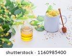 cup of linden tea and linden... | Shutterstock . vector #1160985400