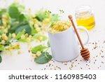 cup of linden tea and linden... | Shutterstock . vector #1160985403