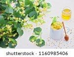 cup of linden tea and linden... | Shutterstock . vector #1160985406