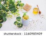cup of linden tea and linden... | Shutterstock . vector #1160985409