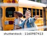 happy teen schoolboy throwing... | Shutterstock . vector #1160987413