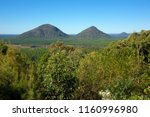 the glass house mountains of... | Shutterstock . vector #1160996980
