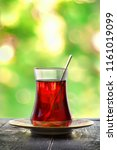 glass of red turkish tea on a... | Shutterstock . vector #1161019099